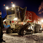 """A worker from seismic exploration company """"Seismorazvedka"""" guides an all-terrain seismic exploration vehicle in the Arctic tundra near Naryan-Mar in the Nenets Autonomous Region. The vehicle, called a """"vibrator"""", is made by French company Sercel and uses seismic vibration to test the structure of the earth crust below to help prospect for oil and gas. Four billion tonnes of gas and oil have been found in the region in the last decade."""