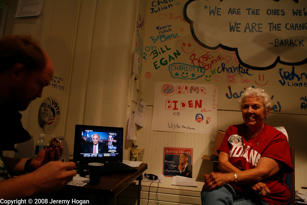 Volunteers at Barack Obama's headquarters in Bloomington, Indiana watch election results posted on television.