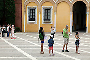 tourist family  at the monument Reales Alcazares Sevilla Spain