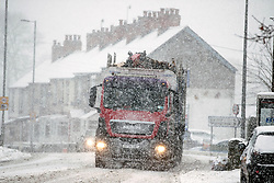© Licensed to London News Pictures. 08/12/2017. Corwen UK. Drivers are facing difficult conditions in the village of Corwen in North Wales as heavy snow continues to fall this today. Photo credit: Andrew McCaren/LNP