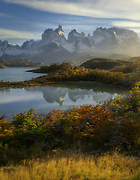 Valley fog, early morning light and reflections in Torres del Paine National Park, Chile