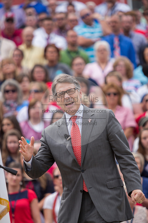 """Former Texas Gov. Rick Perry address a gathering of evangelical Christians during the """"Stand With God"""" rally  August 29, 2015 in Columbia, SC. Thousands of conservative Christians gathered at the State House to rally against gay marriage and listen to GOP presidential candidates Gov. Rick Perry and Sen. Ted Cruz speak."""