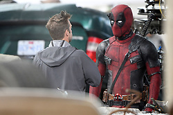 Ryan Reynolds chats with the director on set of Deadpool 2 in costume. Ryan returned to work and was seen doing his own stunt work on set as he climbed on top of a overturned truck. Ryan spent the morning filming in downtown Vancouver after production was halted for 48 hours following the death of a female stunt worker on set. 16 Aug 2017 Pictured: Ryan Reynolds. Photo credit: Atlantic Images/ MEGA TheMegaAgency.com +1 888 505 6342