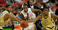 – Atlanta -  GA Tech's  players and Florida state players battle for the loose ball during the quarter finals of the ACC Tournament at the Georgia Dome on Friday, March 13, 2009.   ©2009 Johnny Crawford