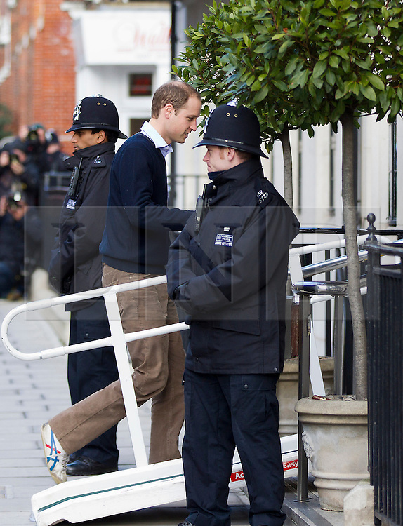 © Licensed to London News Pictures. 05/12/2012. London, UK. Prince William, Duke of Cambridge, arrives at the King Edward VII Hospital in London today (05/12/12) to visit his wife Kate, Duchess of Cambridge, who is staying at the hospital after being diagnosed with hyperemesis gravidarum, a severe form of morning sickness. Photo credit: Matt Cetti-Roberts/LNP