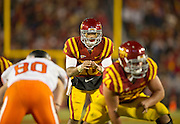 Nov 18, 2011; Ames, IA, USA; Iowa State Cyclones quarterback Jared Barnett (16) waits for the ball behind center Tom Farniok (74) during the second half of a game against the Oklahoma State Cowboys at Jack Trice Stadium. Iowa State Cyclones defeated the Oklahoma State Cowboys 37-31. Mandatory Credit: Beth Hall-US PRESSWIRE Editorial sports photography of the Iowa State Cyclones vs. Oklahoma State Cowboys in 2011 in Aimes, Iowa.