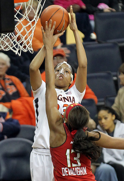 Virginia guard Ataira Franklin (23) shoots over Maryland center Alicia DeVaughn (13) during the game Thursday in Charlottesville, VA. Virginia defeated Maryland 86-72. Photo/The Daily Progress/Andrew Shurtleff