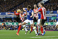Fabio Borini of Sunderland (l) shoots at goal but sees his effort go wide as he is pressured by Leighton Baines of Everton. Premier league match, Everton v Sunderland at Goodison Park in Liverpool, Merseyside on Saturday 25th February 2017.<br /> pic by Chris Stading, Andrew Orchard sports photography.
