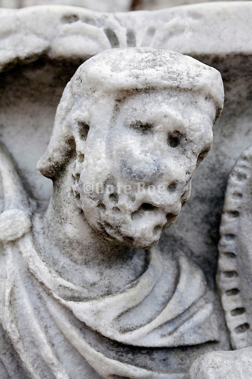 ancient Roman soldier figure with deteriorated head