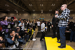 Duane Ballard gets introduced to the crowd at the Annual Mooneyes Yokohama Hot Rod and Custom Show. Japan. Sunday, December 7, 2014. Photograph ©2014 Michael Lichter.