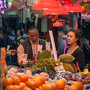 Buying fresh fruit and vegetables at a street market, Mong Kok, Hong Kong