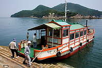 Sensuijima Ferryboat - Tomonoura Port -  The Inland Sea is the body of water separating in between the main islands of Japan.  Because of this, the Seto Naikai is almost as calm as a lake.  Though a few ferries still exist in this part of Japan, since many of the smaller islands are unihabited, boat service is drying up.