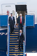 U.S. President Donald Trump walks down the steps with Boeing Commercial Aircraft CEO Kevin McAllister, left, as Boeing CEO Dennis Muilenburg, right, walks ahead after touring the new Boeing 787-10 Dreamliner aircraft at the Boeing factory February 17, 2016 in North Charleston, SC. Trump is at the factory for the rollout of the new aircraft.