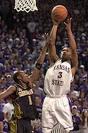 Kansas State guard Lance Harris (R) scores over Missouri's Jimmy McKinney (L) during K-State's 79-64 win over the Tigers at Bramlage Coliseum in Manhattan, Kansas, January 21, 2006.