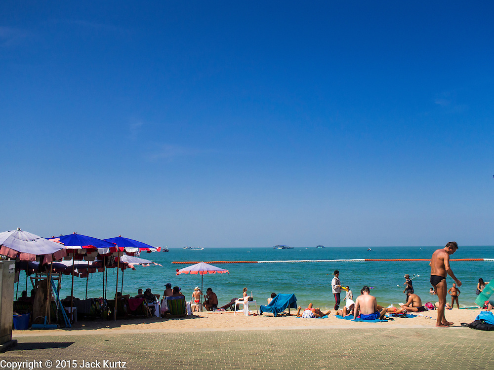 06 JANUARY 2015 - PATTAYA, CHONBURI, THAILAND: Pattaya beach. The Thai government has announced plans to clean up Pattaya beach, one of the most famous beaches in Thailand. Pattaya is about 2.5 hours from Bangkok. They plan to reduce the number of umbrella and chaise lounge vendors on the beach and regulate the personal watercraft and parasailing vendors on the beach. The government has already cleaned up beaches on Phuket island and Hua Hin.    PHOTO BY JACK KURTZ