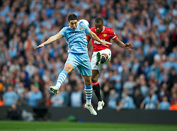 MANCHESTER, ENGLAND - Monday, April 30, 2012: Manchester City's Samir Nasri in action against Manchester United's Patrice Evra during the Premiership match at the City of Manchester Stadium. (Pic by Chris Brunskill/Propaganda)