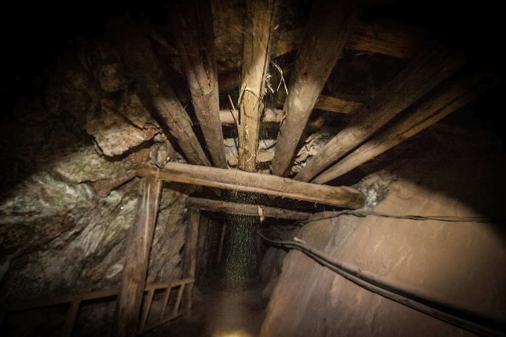 dust falling from the ceiling inside the mine