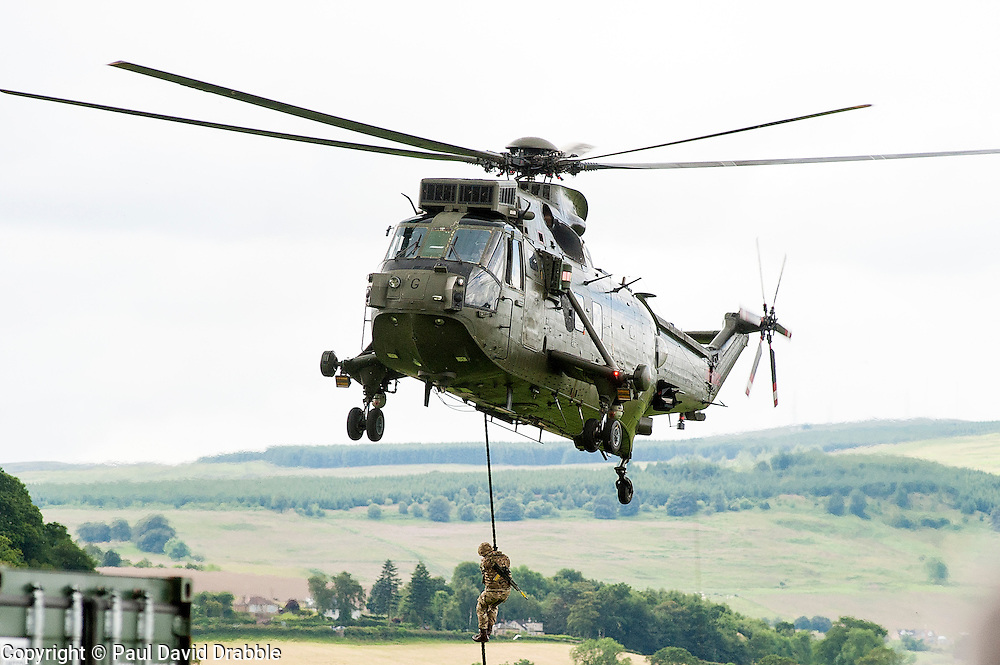 In the Shadow of Sterling Castle and Walace's Monument 1,000's of servicemen and women take part in the 6th Annual Armed Forces Day. <br /> Troops Rope down from a Sea-king Helicopter during a Military Capability Display<br /> <br /> June 29 2014<br /> Copyright Paul David Drabble<br /> www.pauldaviddrabble.co.uk