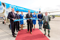 Inverness Airport welcomed KLM's Inaugural flight from Amsterdam. To celebrate the new route, the first flight from Schiphol, Amsterdam was greeted by a water cannon salute upon arrival.  On board were Barry ter Voert, Senior Vice President, Air France KLM European Markets and Wilco Swejen, Director for Aviation Marketing, Schipol Airport.  Provost Helen Carmichael, The Highland Council, Inglis Lyon, Managing Director of Highlands and Islands Aiports and Drew Hendry MP (Inverness, Nairn, Badenoch and Strathspey) met the delegation, officially welcoming the group to the Highlands. <br /> <br /> Pictured: Barry ter Voert, Senior Vice President, Air France KLM Eorpoean Markets cuts the ribbon.<br /> <br /> Malcolm McCurrach | EEm | Tue, 17, May, 2016