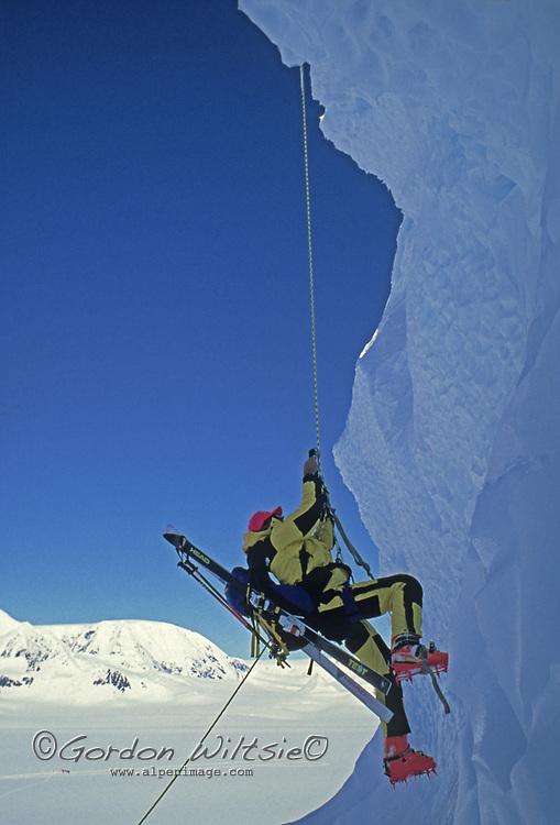 ANTARCTICA, Ski mountaineer Mike Farny (MR) climbs Mount Berry, Danco Coast, Antarctic Peninsula, during Warren Miller ski movie filming.
