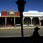 A man walks down the main street in the old western town of Tombstone, Arizona where the famous gunfight at the OK Corral took place. Photo by Todd Bigelow/Aurora