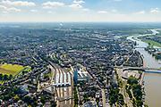 Nederland, Gelderland, Arnhem, 29-05-2019; overzicht Arnhem met Nederrijn, onder in beeld Arnhem centraal, Station Arnhem. Het nieuwe stationsgebouw (architect UNStudio, Ben van Berkel), inclusief nieuwe perron overkappingen. Naast de OV terminal met busstation, twee kantoorgebouwen, de Parktoren van ATOS en WTC Arnhem Nijmegen.<br /> The new Arnhem Central Station and surroundings.<br /> <br /> luchtfoto (toeslag op standard tarieven);<br /> aerial photo (additional fee required);<br /> copyright foto/photo Siebe Swart