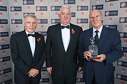 CARDIFF, WALES - Wednesday, November 11, 2009: Wales' special award winner Ken Jones with President Phil Pritchard (C) and Colin Baker during the Football Association of Wales Player of the Year Awards hosted by Brains SA at the Cardiff City Stadium. (Pic by David Rawcliffe/Propaganda)