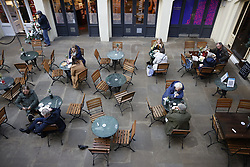 © Licensed to London News Pictures. 15/12/2020. London, UK. Visitors to Covent Garden enjoy a meal in central London. London and other areas of the south east are to enter tier three restrictions at midnight tonight as Covid-19 infection rates rise. Photo credit: Peter Macdiarmid/LNP