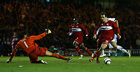 Photo: Jed Wee.<br /> Middlesbrough v FC Basle. UEFA Cup. Quarter-Final. 06/04/2006.<br /> <br /> Middlesbrough's Mark Viduka (R) rounds Basle goalkeeper Pascal Zuberbuhler to score his second goal of the evening to give his team hope again.