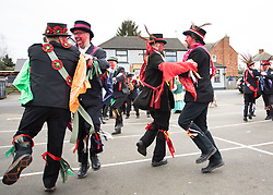 "© Licensed to London News Pictures. 11/01/2020. Sharnford, Leicestershire, UK. Plough Tour. The Hinckley Bullockers taking part in their annual plough tour. Painting their faces red they dance and pull a decorated plough through villages in Leicestershire. The picture shows them performing in Sharnford where they play and dance outside two public houses before moving on to other villages finishing at the end of the day. Traditionally the plough was prepared for the new season, dressed in gaudy ribbons and taken in procession around the villages. In South West Leicestershire the men pulling the plough, who ""raddled"" their faces with red dye thought to be a nod to sheep stealing. They became known as Plough Bullocks and were aided and abetted by dancers who danced dances peculiar to the Eastern Counties. The Plough Bullocks and the Molly Dancers were last seen in this area at the turn of the century in Sapcote. The Plough Bullockers would stop at public houses, farms and large houses, dance and/or sing and demand recognition in the form of cash donations or drink. If neither was forthcoming the offending landlord's drive was ploughed up. Photo credit: Dave Warren / LNP"