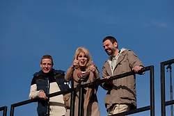 © Licensed to London News Pictures. 23/02/2012. LONDON, UK. Actress Joanna Lumley gives a thumbs up as she stands between artists Micheal Elmgreen (L) and Ingar Dragset (R) after unveiling Trafalgar Square's newest addition. Unveiled by actress Joanna Lumey today (23/02/12) in Trafalgar Square, Elmgreen and Dragset's 'Powerless Structures, Fig. 101' replaces the previous sculpture of a ship in a bottle on the famous Fourth Plinth. Photo credit: Matt Cetti-Roberts/LNP