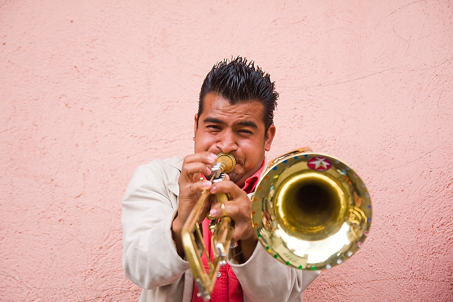 A trombone player blows into his horn at a parade in Paracho, Michoacan state, Mexico on August 7, 2008 during the annual Feria Internacional de la Guitarra.
