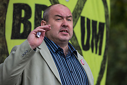 Joe Rukin from Stop HS2 addresses a HS2 Rebellion protest rally in Parliament Square on 4 September 2020 in London, United Kingdom. The rally, and a later protest action at the Department of Transport during which activists glued themselves to the doors and pavement outside and sprayed fake blood around the entrance, coincided with an announcement by HS2 Ltd that construction of the controversial £106bn high-speed rail link will now commence.
