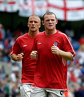 Fotball<br /> Foto: Jed Wee, Digitalsport<br /> NORWAY ONLY<br /> England v Island<br /> <br /> England v Iceland, Manchester Tournament, 05/06/2004.<br /> England's Wayne Rooney (R) warms down at half time with David Beckham after a job well done.