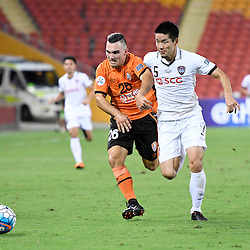 BRISBANE, AUSTRALIA - FEBRUARY 21: Nicholas D'Agostino of the Roar and Naoaki Aoyama of Muangthong United compete for the ball during the Asian Champions League Group Stage match between the Brisbane Roar and Muangthong United FC at Suncorp Stadium on February 21, 2017 in Brisbane, Australia. (Photo by Patrick Kearney/Brisbane Roar)