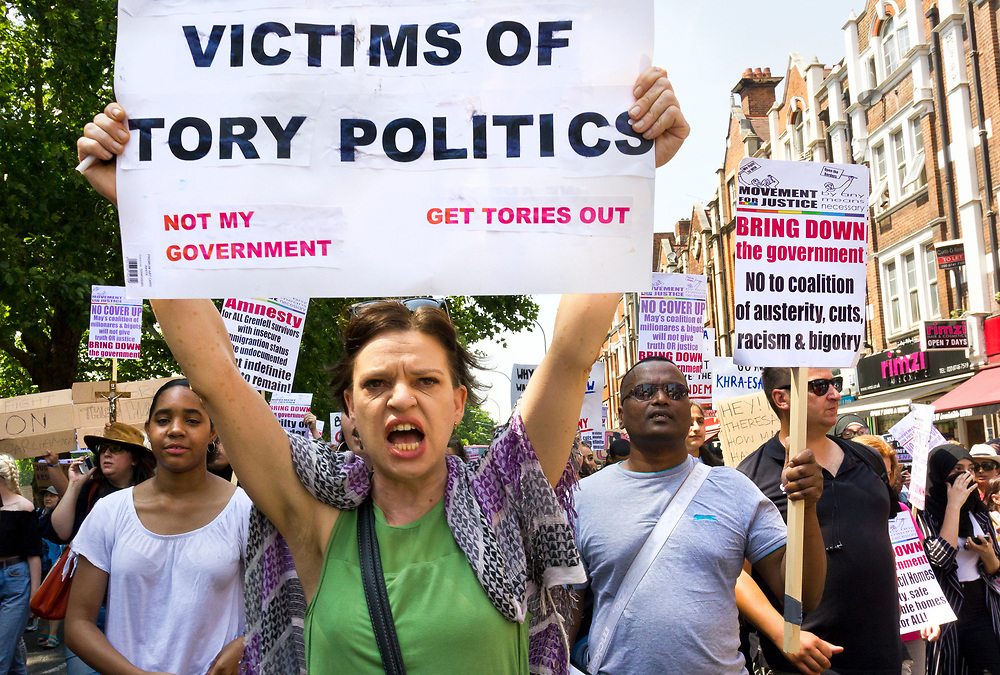 21 June 2017 taken between the hours of 11.53 - 14.28<br /> <br /> The demonstration march, from Shepherd's Bush to Westminster was started by Movement for Justice By Any Means Necessary (MFJ). It was  a day of action for the victims of the inferno that left at least 79 dead.<br /> <br /> <br /> The Grenfell Tower fire occurred on 14 June 2017 at the 24-storey, 220-foot-high (67 m), Grenfell Tower block of public housing flats in North Kensington, Royal Borough of Kensington and Chelsea, West London. It caused at least 80 deaths and over 70 injuries. A definitive death toll is not expected until at least 2018. As of 5 July 2017, 21 victims had been formally identified by the Metropolitan Police. Authorities were unable to trace any surviving occupants of 23 of the flats.<br /> <br /> Emergency services received the first report of the fire at 00:54 local time. It burned for about 60 hours until finally extinguished. More than 200 firefighters and 45 fire engines from stations all over London were involved in efforts to control the fire. Many firefighters continued to fight pockets of fire on the higher floors after most of the rest of the building had been gutted. Residents of surrounding buildings were evacuated due to concerns that the tower could collapse, but the building was later determined to be structurally sound.<br /> <br /> The tower contained 129 flats. Police were unable to trace any survivors from 23 of these, and their occupants are believed to have died in the fire. Firefighters rescued 65 people. Seventy-four people were confirmed to be in six hospitals across London, and 17 of them were in a critical condition. The fire started in a fridge-freezer on the fourth floor. The growth of the fire is believed to have been accelerated by the building's exterior cladding.  ( Source Wikipedia}