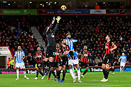Asmir Begovic (27) of AFC Bournemouth leaps up to claim the ball during the Premier League match between Bournemouth and Huddersfield Town at the Vitality Stadium, Bournemouth, England on 4 December 2018.