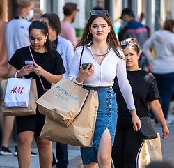 © Licensed to London News Pictures. 15/06/2020. London, UK. A young shopper in Kingston, South West London as non essential shops are given the green light to open in England after 3 months of being closed due to the coronavirus pandemic. Also commuters are told to wear face masks from Monday while travelling on Public transport. Photo credit: Alex Lentati/LNP