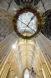 Licensed to London News Pictures 25/11/2016<br /> The advent wreath is suspended beneath the centarl tower of York Minster today.  Measuring 4m in diameter it's believed to be the largest suspended wreath in any church or cathedral in the UK - and possibly the world.  The five candles weighing 4kg's each are lit each Sunday of Advent beginning on Sunday 27 November.  The fifth candle is lit on Christmas Day.  The tradition of advent wreaths dates back to the Middle Ages.  Photo Credit: Sam Atkins/LNP