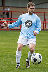 © Licensed to London News Pictures . 02/08/2015 . Droylsden Football Club , Manchester , UK . Actor KELVIN FLETCHER on the ball . Celebrity football match in aid of Once Upon a Smile and Debra , featuring teams of soap stars . Photo credit : Joel Goodman/LNP