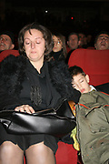 Feb 10, 2008 - Pristina, Kosovo, Serbia - LINDITA XHELADINI, left, and OLTI XHELADINI, wife and son of Martyr Arben Xheladini, at the Pristina National Theatre marking the one-year anniversary of the death of the two martyrs, Xheladini and Mon Balaj who were killed by UN police on Feb 10, 2007 during a protest.<br /> (Credit Image: © Vedat Xhymshiti/ZUMA Press)