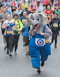 © Licensed to London News Pictures; 15/03/2020; Bath, UK. A person dressed as an elephant runs in the Bath Half Marathon during the coronavirus crisis. There have been calls to cancel or postpone the event after many other sporting and other events have been cancelled or postponed as cases of infection and deaths due to the virus increase across the UK, and the Government plans to bring in legislation to ban all large public gatherings perhaps as early as next weekend. Organisers of the half marathon say they have taken advice that the risk is low and say that it is too late to cancel the event. Photo credit: Simon Chapman/LNP.