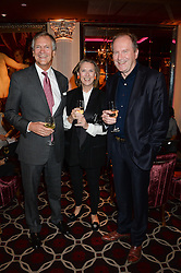 Left to right, CHARLES DELEVINGNE, SUSAN BOYD and writer WILLIAM BOYD at a party to celebrate the publication of 'Passion for Life' by Joan Collins held at No41 The Westbury Hotel, Mayfair, London on21st October 2013.