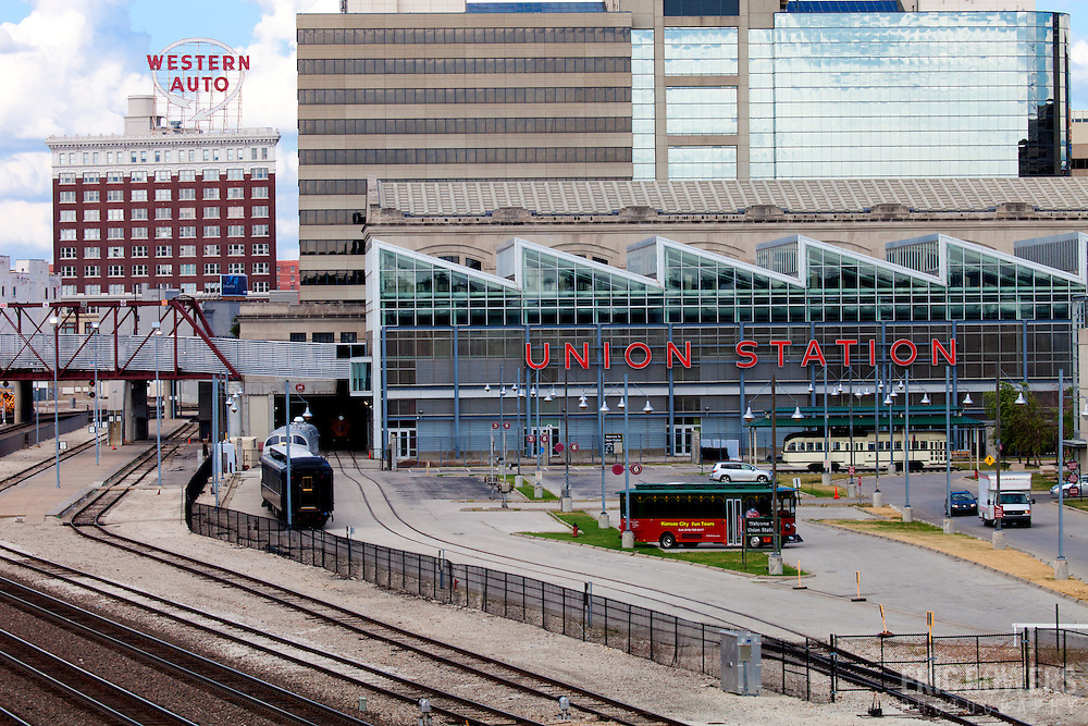 Downtown Kansas City's Western Auto building with Union Station and railroad tracks.