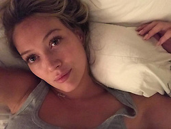 """Hilary Duff releases a photo on Twitter with the following caption: """"""""Night night. Didn't wear make up today ... felt so good. Hope everyone had a healthy happy 4th ❤️"""""""". Photo Credit: Twitter *** No USA Distribution *** For Editorial Use Only *** Not to be Published in Books or Photo Books ***  Please note: Fees charged by the agency are for the agency's services only, and do not, nor are they intended to, convey to the user any ownership of Copyright or License in the material. The agency does not claim any ownership including but not limited to Copyright or License in the attached material. By publishing this material you expressly agree to indemnify and to hold the agency and its directors, shareholders and employees harmless from any loss, claims, damages, demands, expenses (including legal fees), or any causes of action or allegation against the agency arising out of or connected in any way with publication of the material."""