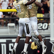 UCF Knights defensive back Brandon Alexander (37) and UCF Knights defensive back Clayton Geathers (26) celebrate during an NCAA football game between the South Carolina Gamecocks and the Central Florida Knights at Bright House Networks Stadium on Saturday, September 28, 2013 in Orlando, Florida. (AP Photo/Alex Menendez)