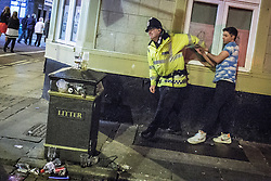 © Licensed to London News Pictures . FILE PICTURE DATED 05/05/2013 of a policeman detaining a man following a domestic dispute in Central Manchester overnight as the British Home Secretary , Theresa May , takes questions at the annual Police Federation conference on licensing and policing the night time economy , today (Wednesday 15th May 2013) . Photo credit : Joel Goodman/LNP