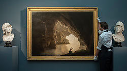 "© Licensed to London News Pictures. 04/12/2015. London, UK. A technician presents ""A grotto in the Gulf of Salerno, with the figure of Julia, banished from Rome"" by Joseph Wright of Derby (est. £100,000-150,000), ahead of Sotheby's London evening sale of Old Master and British paintings on 9th December 2015. This is the last official image of his reign.  Photo credit : Stephen Chung/LNP"