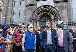 A Peace vigil has been held at a Sikh temple in the Leith district of Edinburgh. The vigil, called by the Muslim Women's Association of Edinburgh and supported by Stand up to Racism Edinburgh, follows a fire at the temple. A 49 year-old man has been charged over the incident.<br /> <br /> Pictured: Edinburgh council leader, Adam McVey speaking during the vigil