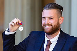 London Bridge Terror Attack hero Constable Charles Guenigault admires his George Medal following an investiture by Her Majesty The Queen at Buckingham Palace in London. London, October 11 2018.